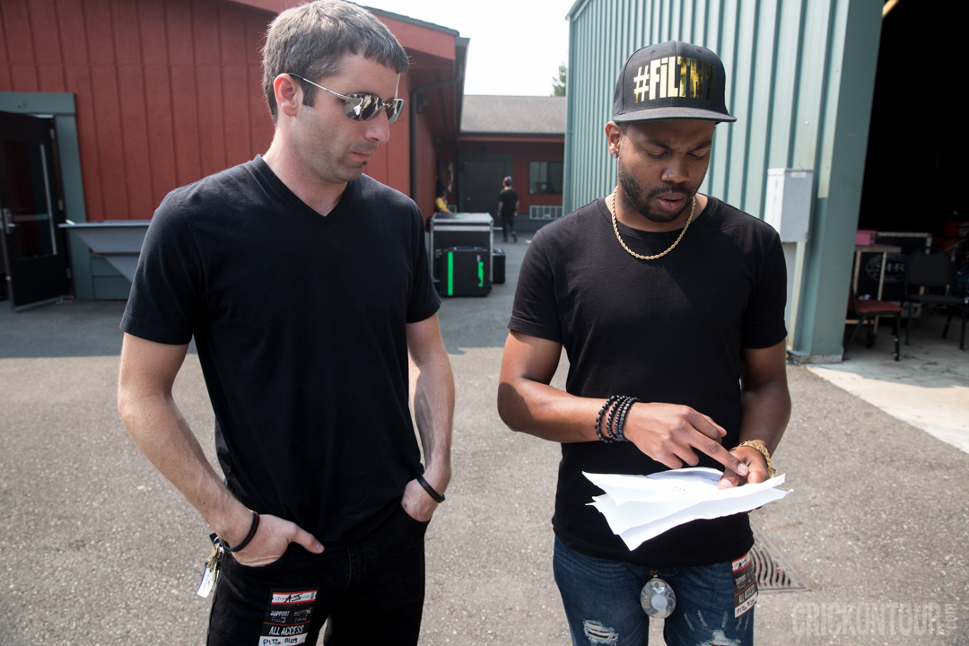 Mackenzie McAninch and Ayron Jones reviewing the setlist before taking the stage at KISW's Pain in the Grass. (Photo: Alex Crick)