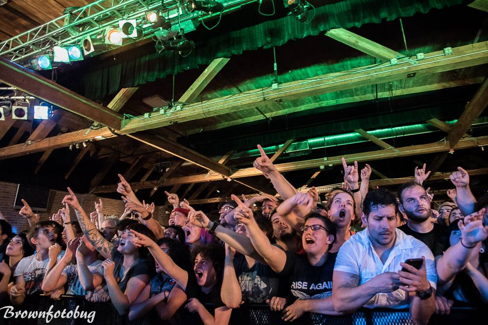 Don't be that guy (on his phone) at a recent Rise Against show. (Photo: Arlene Brown)